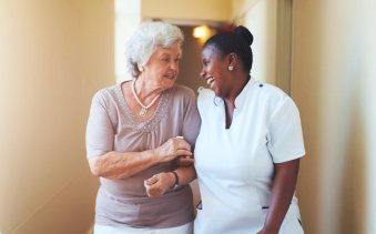 caregiver and elder woman talking
