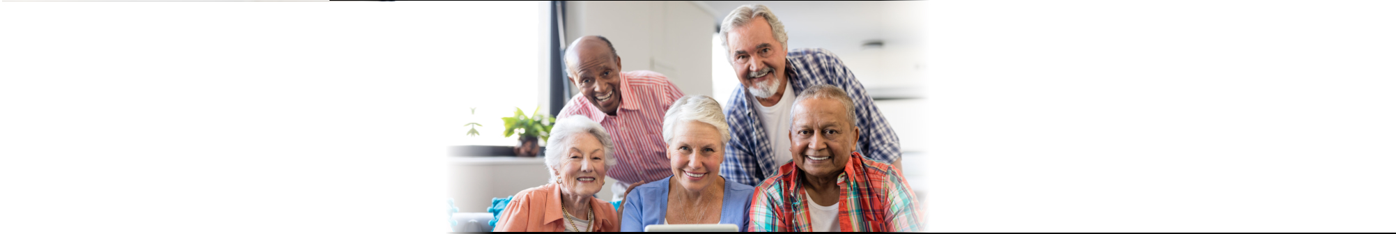 group of elderly couples smiling