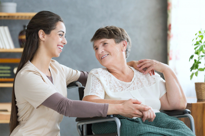 caregiver and old woman enjoying each other's presence